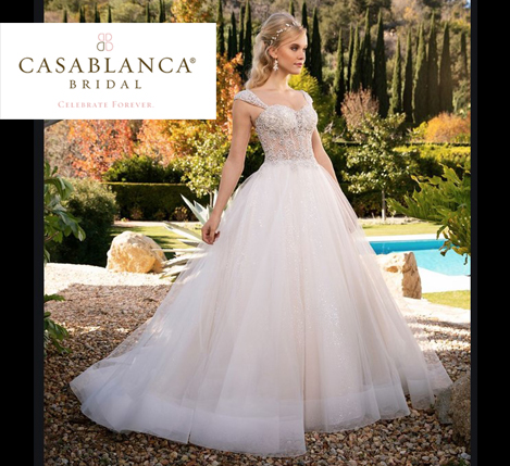 Casablanca style 2374 is featured for the Casablanca Trunk Show