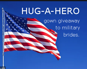 Image of US flag waving in the blue sky with HUG A HERO written in white