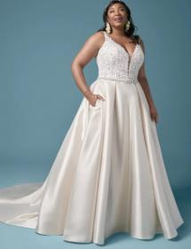 This style is in Plus Size in our store for you to try on! Women modeling MB Bride SKU 73077